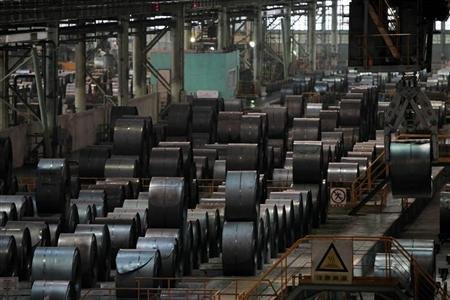 A stainless steel product line is seen at a factory of Baosteel Group Corp., China's biggest steel maker, in Shanghai July 6, 2010. REUTERS/Aly Song