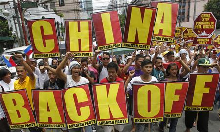 Protesters chant anti-China slogans as they march towards the Chinese consulate in Manila's Makati financial district in this May 11, 2012 file photo. REUTERS/Erik De Castro/Files