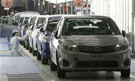 Workers check Toyota Motor Co's newly produced Corolla vehicles at the company's subsidiary Central Motor's Miyagi plant following a line-off ceremony in Ohira village of Miyagi prefecture, northern Japan, May 11, 2012. REUTERS/Yuriko Nakao