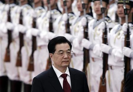 China's President Hu Jintao inspects an honour guard during an official welcoming ceremony for Colombia's President Juan Manuel Santos (not pictured) at the Great Hall of the People in Beijing May 9, 2012. REUTERS/Jason Lee