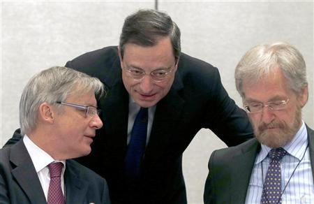 European Central Bank (ECB) President Mario Draghi (C) speaks to France's Central Bank Governor Christian Noyer (L) and Member of the Executive Board of the ECB Peter Praet before the start of an ECB meeting in Barcelona May 3, 2012. REUTERS/Alberto Estevez/Pool