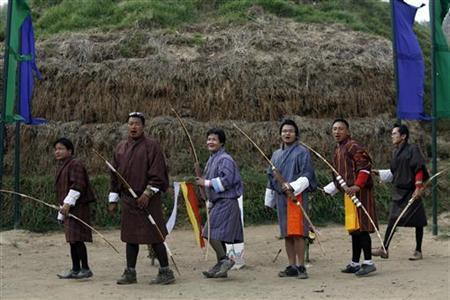 Bhutanese archers react after hitting the target during a weekend traditional archery tournament at Changlimethang stadium May 23, 2012. REUTERS/Singye Wangchuk