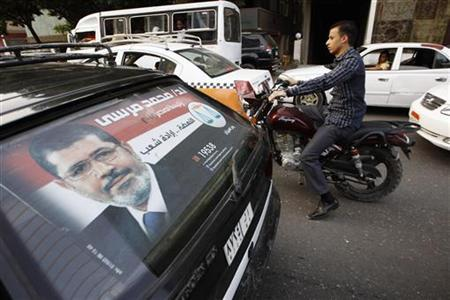 A campaign poster for presidential candidate Mohamed Mursi is seen on the back of a car in Cairo May 22, 2012. REUTERS/Ammar Awad