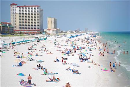 Bathers relax on Pensacola Beach, Florida REUTERS/Matthew Bigg