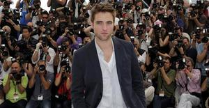 """Cast member Robert Pattinson poses during a photocall for the film """"Cosmopolis"""", in competition at the 65th Cannes Film Festival May 25, 2012. REUTERS/Eric Gaillard"""