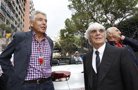 Formula One chairman Peter Brabeck-Letmathe (L) looks on next to Formula One commercial supremo Bernie Ecclestone during the Monaco F1 Grand Prix May 25, 2012. REUTERS/Max Rossi
