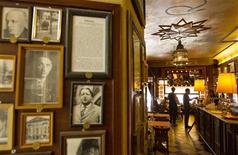 Portraits of writer Joseph Roth's contemporaries are seen in the Joseph Roth Diele restaurant in Potsdamer Street in Berlin, May 24, 2012. REUTERS/Thomas Peter