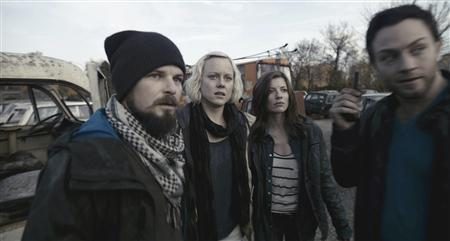 The cast of Chernobyl Diaries (L-R) Nathan Phillips, Ingrid Bolso Berdal, Devin Kelley and Jonathan Sadowski are shown in this undated publicity handout released to Reuters. Horror film ''Chernobyl Diaries'' with its ghostly tale of terror near the infamous, abandoned nuclear plant hits theaters on Friday after drawing protests from some who view it as sensationalizing a disaster that had tragic human consequences. REUTERS/Warner Bros. Pictures/Handout