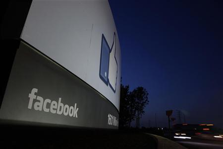 Traffic flies by the entrance sign to Facebook headquarters in Menlo Park, California before the company's IPO launch, May 18, 2012. REUTERS/Beck Diefenbach