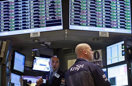 Traders work at the Knight Capital kiosk on the floor of the New York Stock Exchange, in this February 21, 2012, file photo. REUTERS/Brendan McDermid/Files