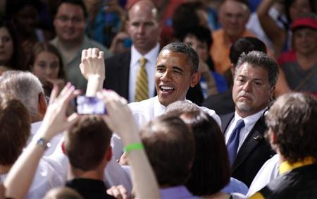 President Barack Obama greets supporters during a campaign rally at the Iowa State Fairgrounds in Des Moines, Iowa May 24, 2012. REUTERS/Kevin Lamarque