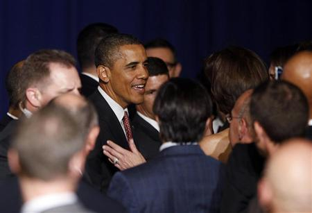 U.S. President Barack Obama greets audience members at a gala fundraiser for the gay community in New York City June 23, 2011. REUTERS/Jason Reed