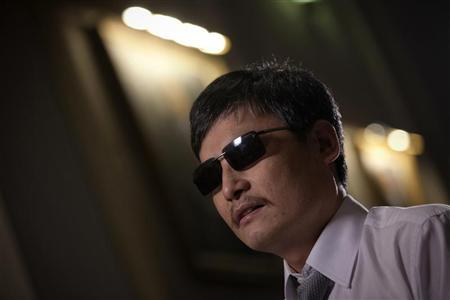 Chen Guangcheng, the blind Chinese dissident and legal advocate who recently sought asylum in the United States, gives an interview in New York May 24, 2012. REUTERS/Shannon Stapleton