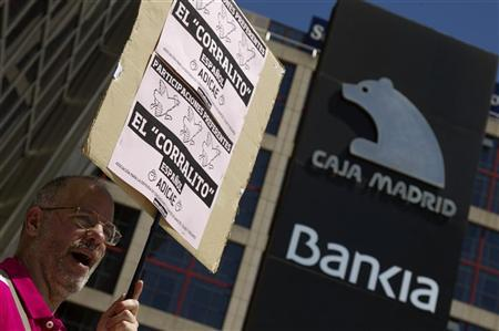 A man shouts slogans during a protest outside headquarters of Spain's fourth largest bank Bankia in Madrid May 24, 2012. REUTERS/Sergio Perez