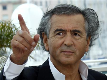 Director Bernard-Henry Levy poses during a photocall for the film ''Le Serment de Tobrouk'' at the 65th Cannes Film Festival, May 25, 2012. REUTERS/Jean-Paul Pelissier