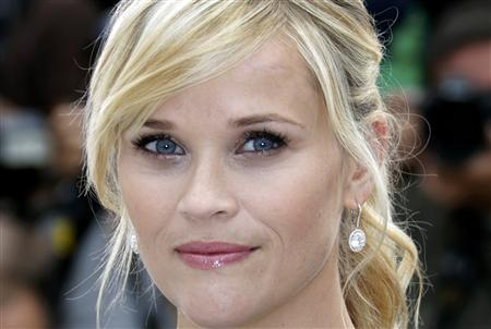 Cast member Reese Witherspoon poses during a photocall for the film ''Mud'', in competition at the 65th Cannes Film Festival, May 26, 2012. REUTERS/Eric Gaillard