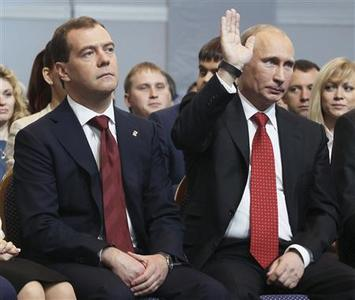 Russia's President Vladimir Putin (R) gestures next to Prime Minister Dmitry Medvedev as they attend a United Russia party congress in Moscow May 26, 2012. REUTERS/Yekaterina Shtukina/RIA Novosti/Pool