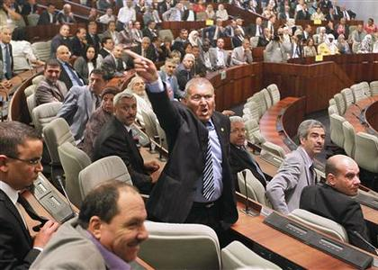 A delegate shouts at other delegates protesting the results of the last parliamentary election, during the opening session of the new National Assembly in Algiers May 26, 2012. REUTERS/Louafi Larbi