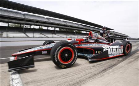 Panther Racing driver J.R. Hildebrand speeds from the pit lane in his car during practice time at the Indianapolis Motor Speedway in Indianapolis May 12, 2012. REUTERS/Brent Smith