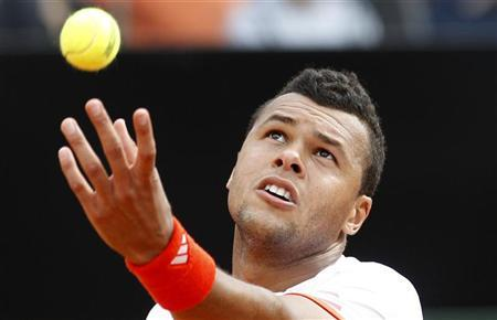 Jo-Wilfried Tsonga of France serves to Novak Djokovic of Serbia during their match at the Rome Masters tennis tournament May 18, 2012. REUTERS/Max Rossi