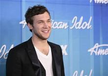 "Winner Phillip Phillips poses in the backroom after the 11th season finale of ""American Idol"" in Los Angeles, California May 23, 2012. REUTERS/Jason Redmond"