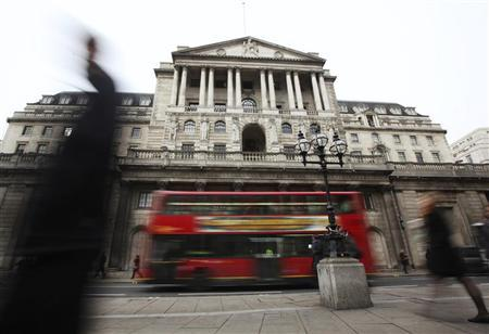 Pedestrians pass The Bank of England in the City of London February 14, 2012. REUTERS/Olivia Harris