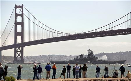 USS Iowa passes under the Golden Gate Bridge en route from Richmond, California to Los Angeles May 26, 2012. REUTERS/Jana Asenbrennerova