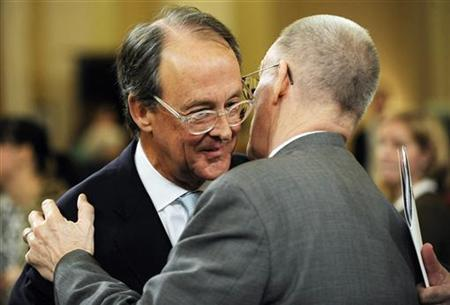 Erskine Bowles (L), co-chairman of the National Commission on Fiscal Responsibility and Reform, hugs an unidentified man as he departs after a U.S. Joint Select Committee on Deficit Reduction hearing on Capitol Hill in Washington, November 1, 2011. REUTERS/Jonathan Ernst