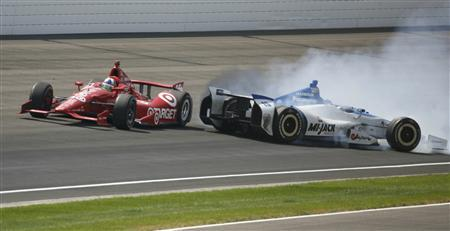 Chip Ganassi Racing driver Dario Franchitti of Scotland goes past a spinning Rahal Letterman Lanigan Racing driver Takuma Sato of Japan near the end of the Indianapolis 500 auto race at the Indianapolis Motor Speedway in Indianapolis, Indiana, May 27, 2012. REUTERS/Frank Polich