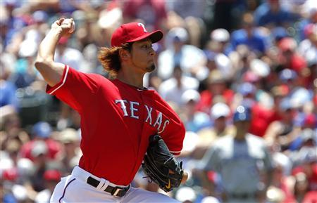 Texas Rangers pitcher Yu Darvish throws against the Toronto Blue Jays in the first inning of their MLB American League baseball game in Arlington, Texas May 27, 2012. REUTERS/Tim Sharp