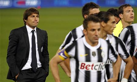 Juventus' coach Antonio Conte (L) looks on after their Italian Cup final soccer match against Napoli at the Olympic stadium in Rome, May 20, 2012. REUTERS/Giampiero Sposito