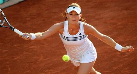 Agnieszka Radwanska of Poland returns the ball to Bojana Jovanovski of Serbia during the French Open tennis tournament at the Roland Garros stadium in Paris May 28, 2012. REUTERS/Francois Lenoir