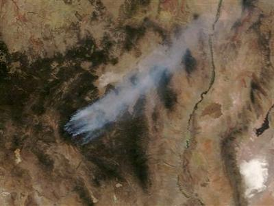 Wildfires burn in New Mexico's Gila National Forest in this NASA satellite image dated May 27, 2012. Diminished winds helped fire crews take the offensive on Sunday against an 11-day-old blaze burning out of control through the rugged high country of New Mexico's Gila National Forest, but nearly 300 homes in the area remained under evacuation. The so-called Whitewater-Baldy fire, which destroyed a dozen privately owned cabins at the height of its rampage last week, has charred well over 122,000 acres (49,000 hectares) of timber since it was ignited by lightning on May 16, fire officials said. REUTERS/NASA/EOSDIS/Handout