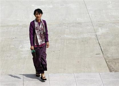 Myanmar pro-democracy leader Aung San Suu Kyi arrives at the lower house of parliament to attend a parliament meeting in Naypyitaw in this May 2, 2012 file photo. Nobel Peace Prize winner Aung San Suu Kyi ventures outside Myanmar for the first time in 24 years on May 29, 2012 in an unmistakable display of confidence in the liberalisation taking shape in her country after five decades of military rule. REUTERS/Soe Zeya Tun/Files