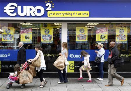 Pedestrians walk past a discount store on Moore Street in Dublin in this July 6, 2011 file photo. Ireland's government oversaw a return to mild economic growth last year but it is quickly learning that its own policies alone will not fix Ireland's debt pile, which will peak at 120 percent of GDP next year. The country desperately needs two things: a stronger global economy so its exporters can begin selling more stuff, and a normalization of sovereign debt markets so Dublin can begin borrowing again and exit its international bailout on schedule next year. Neither appear likely. Picture taken July 6, 2011. REUTERS/Cathal McNaughton/Files