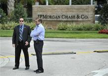 Security guards stand watch outside the JP Morgan Chase & Co annual shareholders meeting at the bank's back-office complex in Tampa, Florida, May 15, 2012. REUTERS/Steve Nesius
