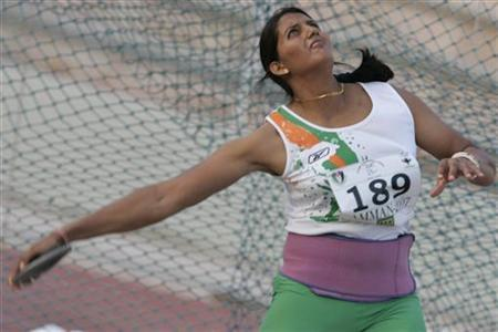 Krishna Poonia competes in the women's discus throw finals during the 17th Asian Athletics Championship at Amman International Stadium in Amman July 28, 2007. REUTERS/Muhammad Hamed/Files