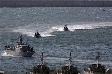 Israeli naval vessels head into port in Ashdod June 30, 2009. REUTERS/Amir Cohen