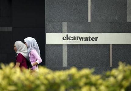 Pedestrians walk past Clearwater Residence, which is popular among Japanese property buyers, in Kuala Lumpur May 28, 2012. REUTERS/Bazuki Muhammad