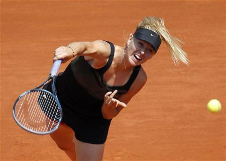 Maria Sharapova of Russia serves to Alexandra Cadantu of Romania during the French Open tennis tournament at the Roland Garros stadium in Paris May 29, 2012. REUTERS/Regis Duvignau
