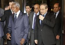 U.N.-Arab League envoy Kofi Annan is seen as he makes his way to meet with Syria's President Bashar al-Assad in Damascus May 29, 2012. Assad met peace envoy Annan on Tuesday, the state news agency SANA said, amid an outcry over a massacre of civilians that U.N. observers attributed at least partly to the army but the government blamed on Islamist militants. At right is Syria's Deputy Foreign Minister Faisal al-Miqdad. REUTERS/Stringer
