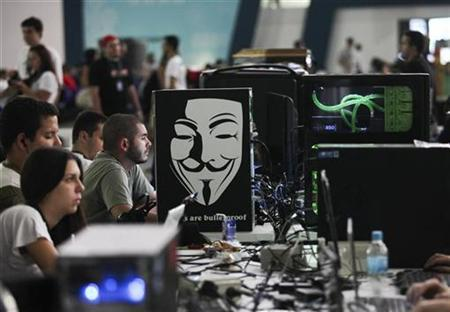 Participants sit at the games area of the Campus Party event in Sao Paulo February 7, 2012. REUTERS/Fernando Donasci/Files