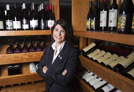 Lorie O'Sullivan, sommelier for TOCA at the Ritz-Carlton in Toronto, poses for a portrait at the inside the wine cellar of the TOCA restaurant in Toronto, May 25, 2012. Leading sommeliers around the globe can help to take the guess work out of selecting wines and the sting out of prices. Looking for bargains, comparative shopping, being open minded, and if in doubt, asking for help, they say are just a few tips to relieve the stress of selecting wines in restaurants. Picture taken May 25. REUTERS/Mark Blinch