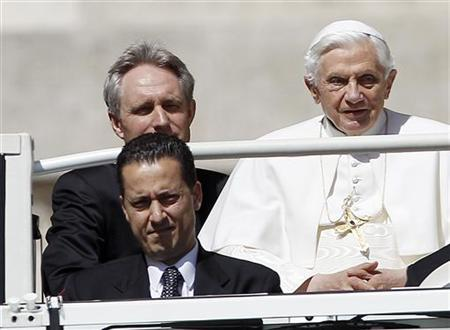 The Pope's butler, Paolo Gabriele (bottom L) arrives with Pope Benedict XVI (R) at St. Peter's Square in Vatican, in this file photo taken May 23, 2012. The butler who serves in the apartments of Pope Benedict XVI was arrested on Friday in connection with an investigation into leaks of confidential documents, a senior Vatican source said. REUTERS/Alessandro Bianchi/Files