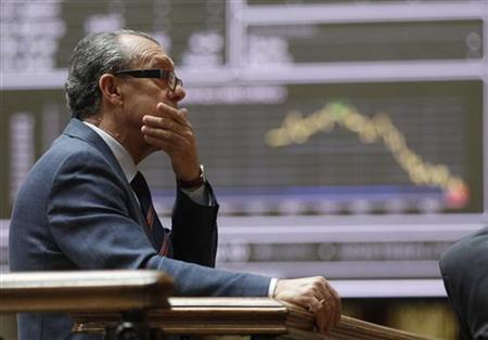 A man reacts while looking at information screens at the Madrid stock exchange May 29, 2012. REUTERS/Andrea Comas
