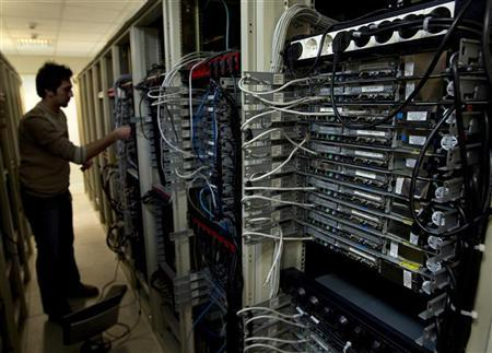 A computer engineer checks equipment at an internet service provider in Tehran February 15, 2011. REUTERS/Caren Firouz