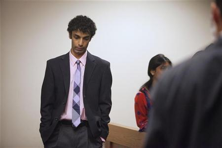 Dharun Ravi stands alone following a sentencing hearing for his conviction in using a webcam to invade the privacy of his roommate, Tyler Clementi, and another man in their college dorm room, in New Brunswick, New Jersey May 21, 2012. The former Rutgers University student was sentenced to 30 days in prison for bias crimes after he spied on his roommate's gay encounter in a case that drew national attention to bullying. REUTERS/Lee Celano