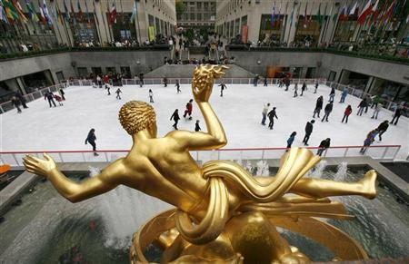 People skate on the ice beneath the gilded statue of Prometheus in Rockefeller Center in New York, October 12, 2009. REUTERS/Mike Segar