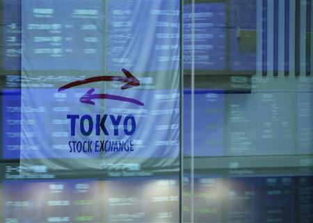 Market prices are reflected in a glass window at the Tokyo Stock Exchange in Tokyo April 11, 2012. REUTERS/Toru Hanai