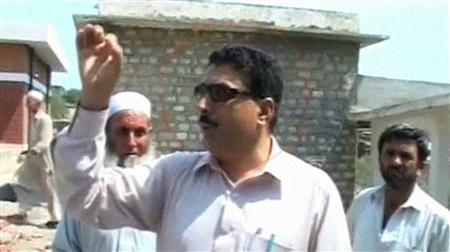 Pakistani doctor Shakil Afridi talks with people outside a building at an unknown location in Pakistan in this still image taken from file footage released on May 23, 2012. REUTERS/Geo News via Reuters TV